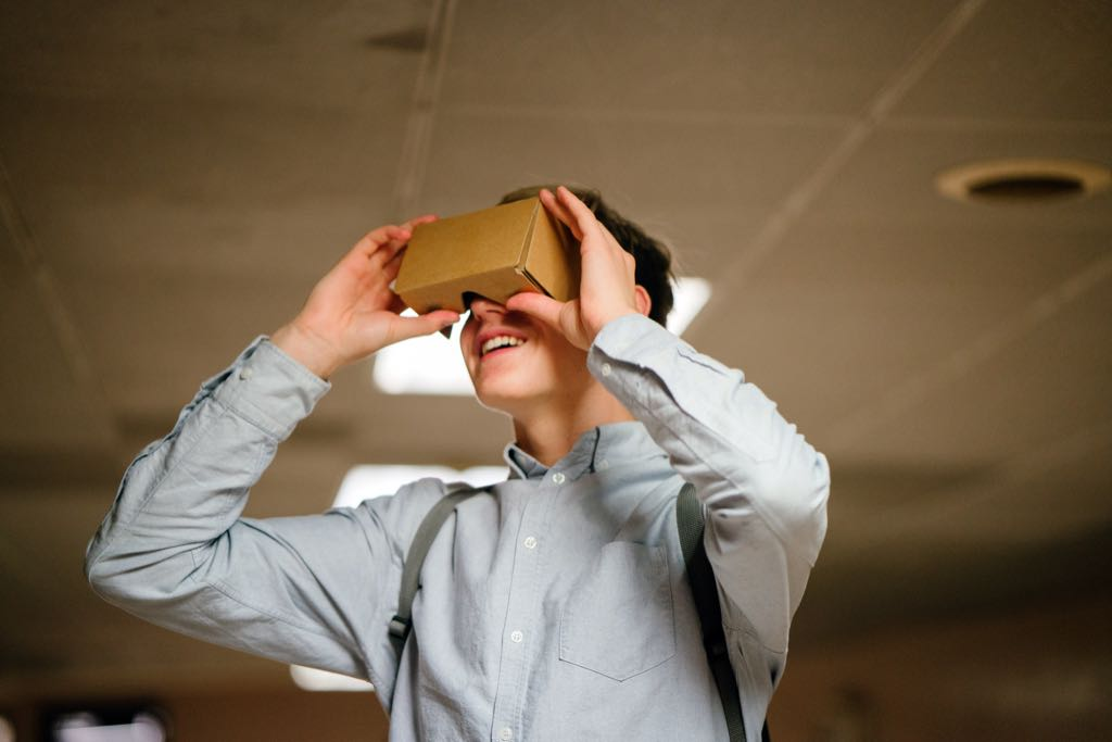 Google Cardboard, a simple viewer made of cardboard and plastic lenses, which uses a regular smartphone as screen.