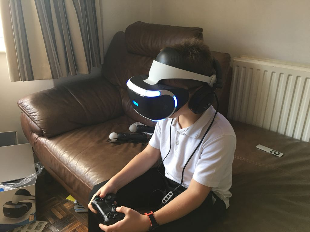 Kid using a PSVR, the VR headset for the Playstation 4.