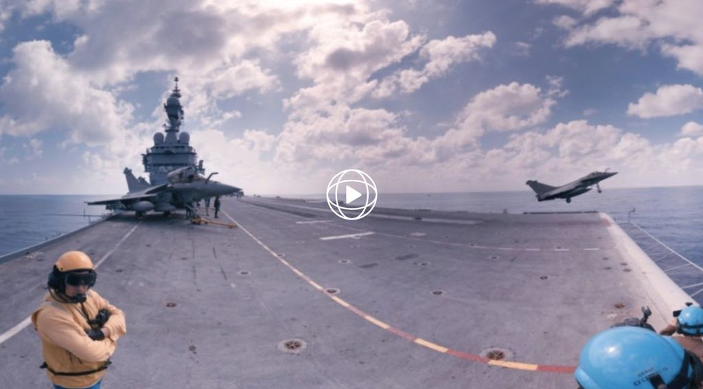 """Stand on an aircraft carrier battling ISIS"" by CNN"