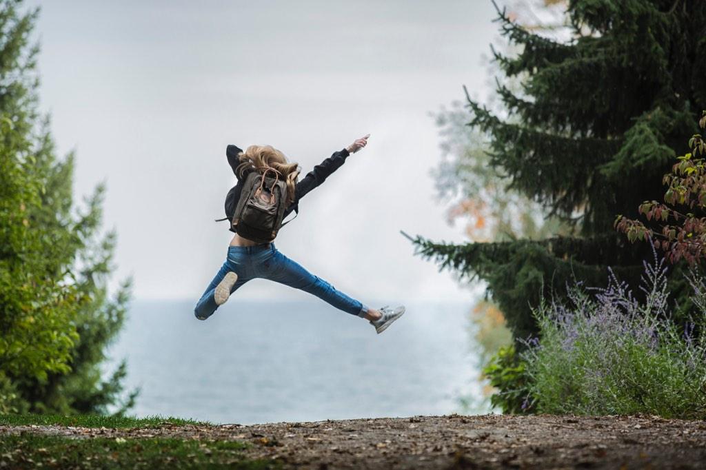 Woman making a happy jump. (Photo by Sebastian Voortman from Pexels)