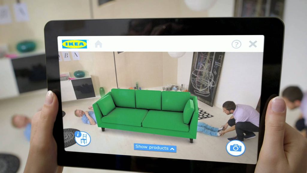 The IKEA app being used on an iPad to place a couch in AR.