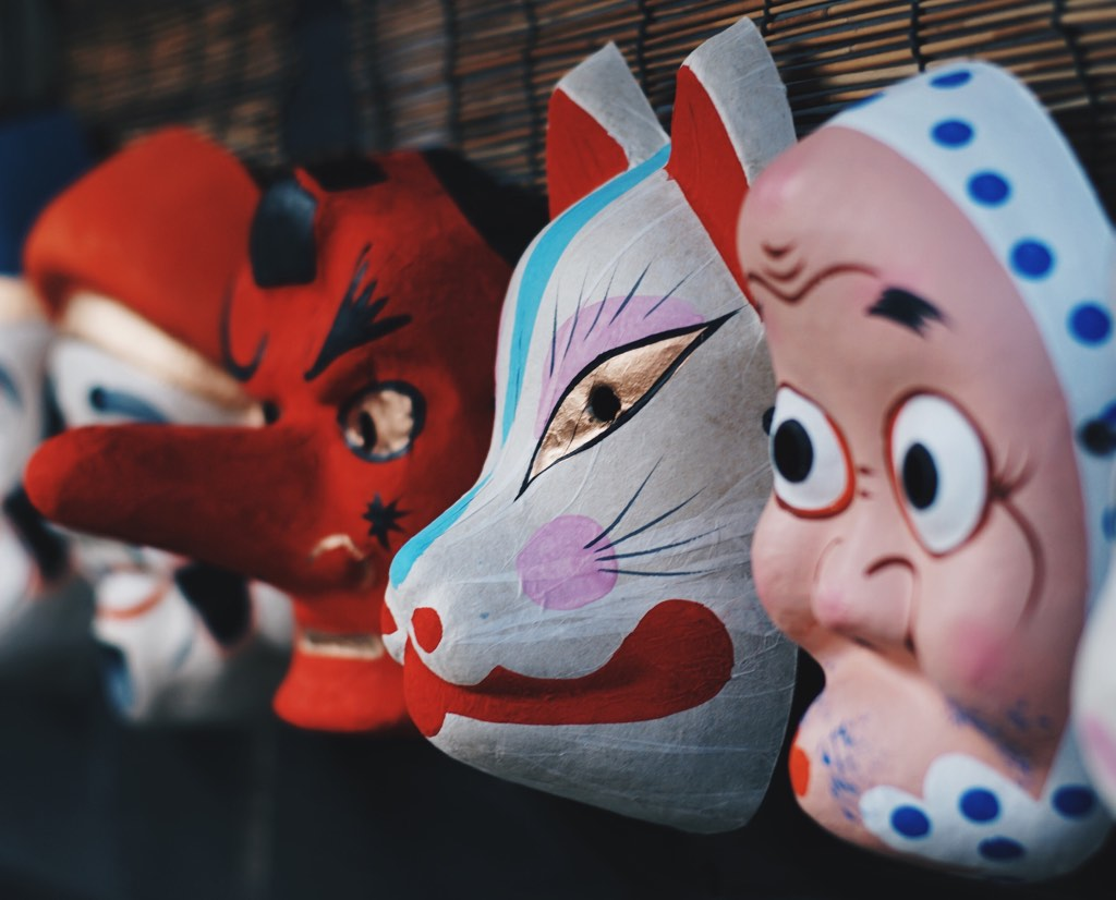 Buyer types as traditional Japanese masks.