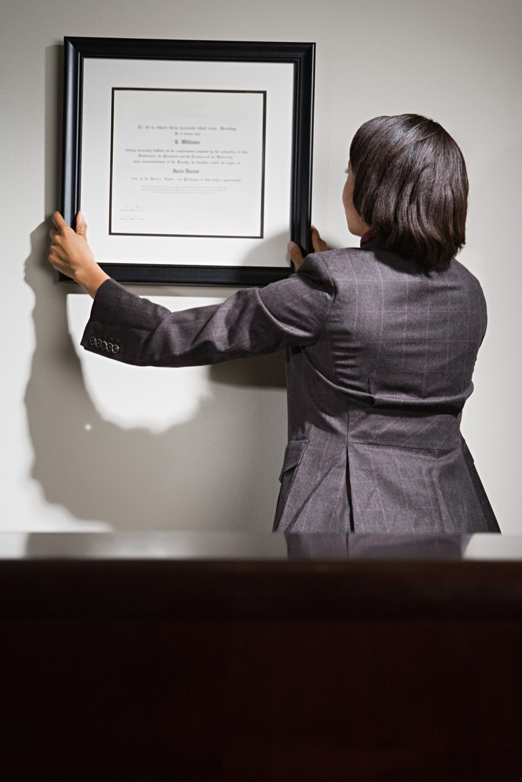Hanging diplomas on the wall might seem outdated and redundant, but quite a few buyers will consider those dead trees significant.